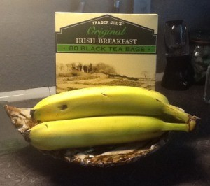 A box of Irish Breakfast tea and three bananas.