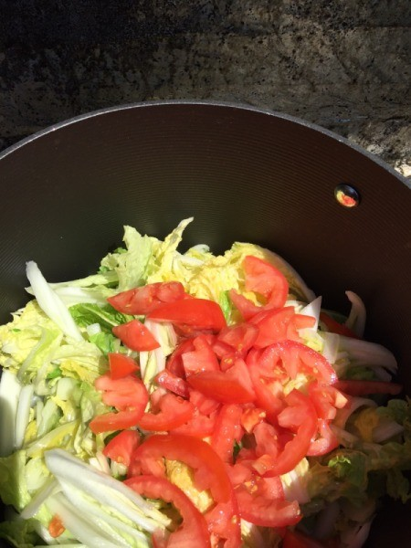 Napa Cabbage and tomato in pan