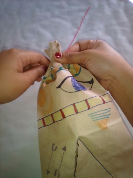 Paper Bag Tent - tying the top closed