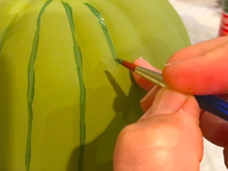 Foam Pumpkin Faux Cactus - paint lines using the dark green paint in the pumpkin grooves