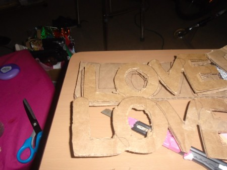 'Love' Cardboard Sign - letters cut out