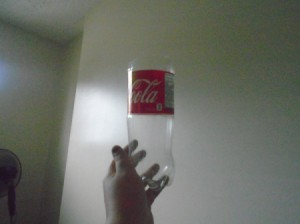 A plastic soda bottle with the top cut off.