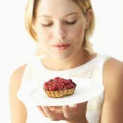 Woman Holding Chocolate Fruit Tart