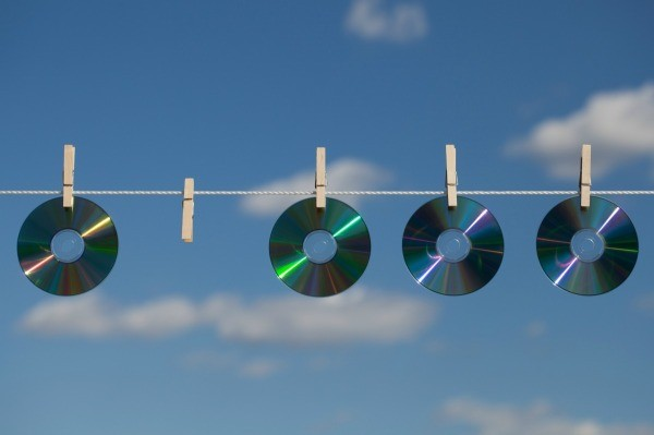 CDs Hanging On Clothesline To Keep Birds Out Of Garden