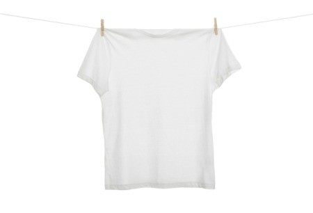 A t-shirt hanging on a clothesline.