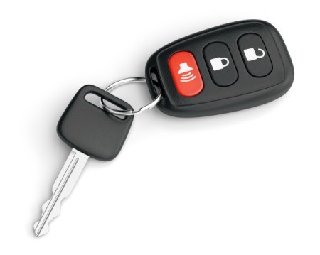 A car with with key fob that has a red panic button.