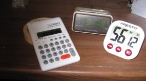 A variety of different timers and alarm clocks.