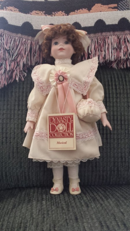 Value of a Musical Dynasty Doll - doll wearing a pink period dress
