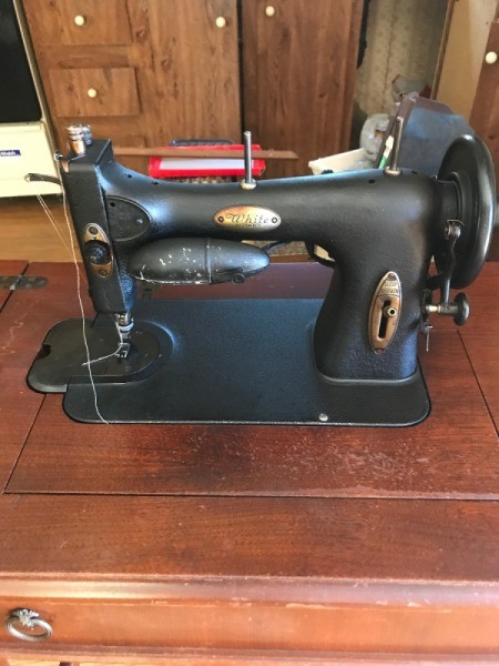 Vintage White Rotary Electric Sewing Machine - old black sewing machine in a mahogany cabient