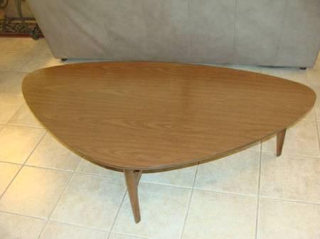 Value of MCM Mersman Coffee Table  - light wood asymmetrical slightly ovoid coffee table