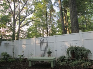 Outdoor Bench Made Easy - bench in garden near fence