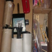 A drawer with the cords neatly stored inside cardboard tubes.