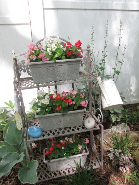 Using A Baker's Rack In Your Garden - rack with pots of flowes