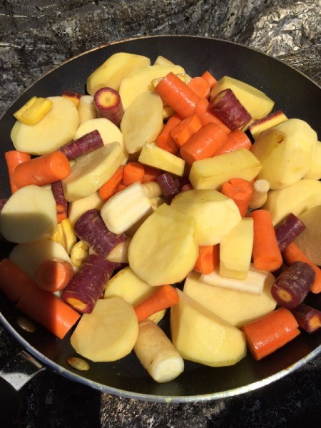 Carrot and potatoes in pan