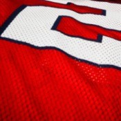 Close-up of a red and white football jersey.