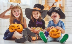 Three kids wearing cute costumes.
