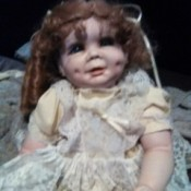 Identifying a Legacy Porcelain Doll - doll wearing yellow dress
