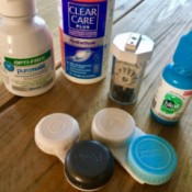 A collection of different products for caring for contact lenses.