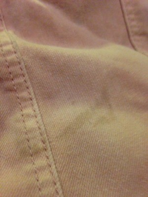 Repairing a Stained Denim Jacket - stain on pink jacket