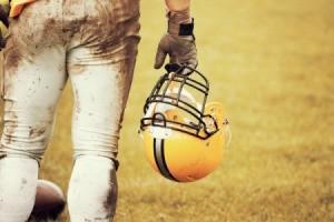 A football player wearing dirty football pants.