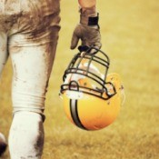 A football player wearing dirty football pants.