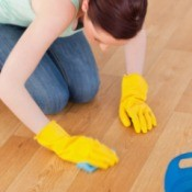 Cleaning an apartment floor with bleach water.