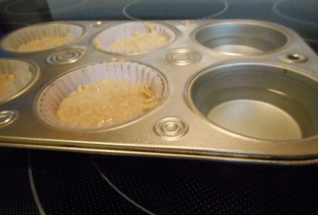 water in empty muffin tin