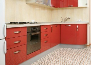 A kitchen with a vinyl floor.