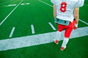 Photo of a kid in a football uniform.
