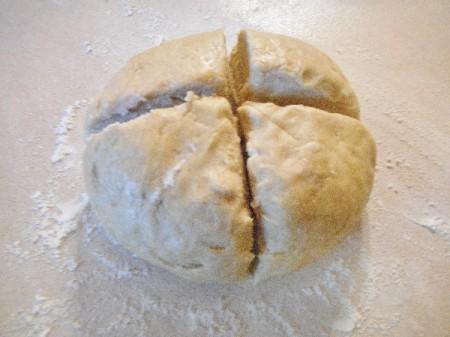 ball od dough cut in quarters