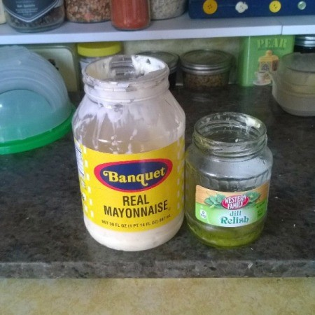 A jar of mayo and one of relish, to be combined to make tartar sauce.