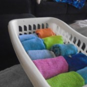 A basket of rolled up washclothes.