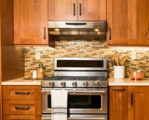 Wood cabinets above a stove.