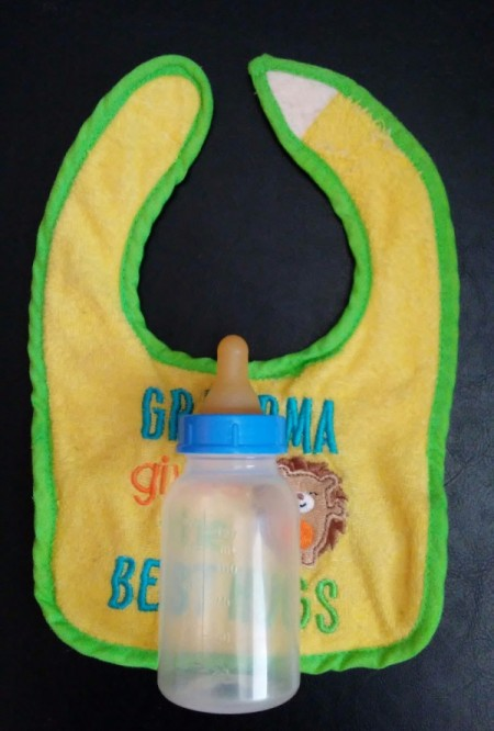Baby Bib Robe - place bottle on bib so that dribbles go onto the bib