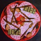 Love Life Charger Plates - words and cutlery from the napkins arranged on the record and decoupaged in place then allow to dry for a few hours
