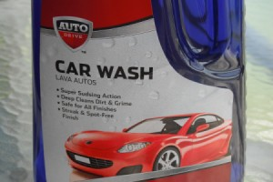 A bottle of Car Wash soap for cleaning vinyl siding and gutters.