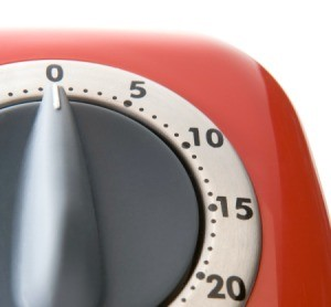 A red kitchen timer.