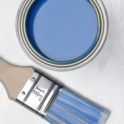 A can of blue paint and a paint brush.