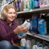 A woman shopping for cleaning products at a store.