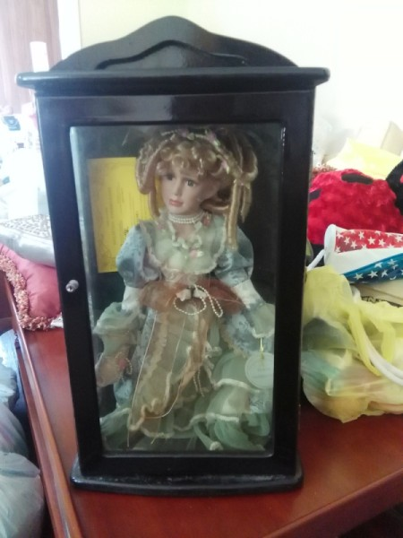 Value of a Knightbridge Collection Doll - doll in a black box with glass front