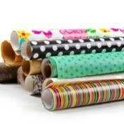 Rolls of colorful wrapping paper on a white background.