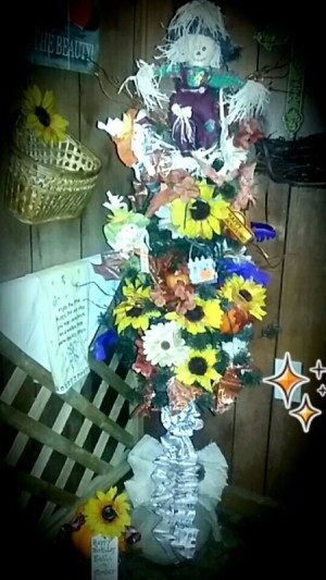 A pencil Christmas tree decorated for fall.