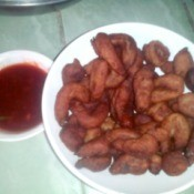 finished Fried Fish Drops on plate with bowl of sauce