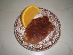 Apple Butter on bread and orange wedge  on plate