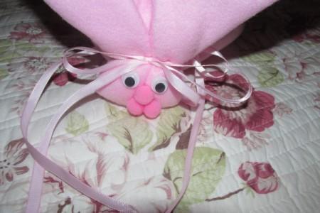 Make Boo-Boo Bunnies For a Baby Shower - tie ribbon behind head