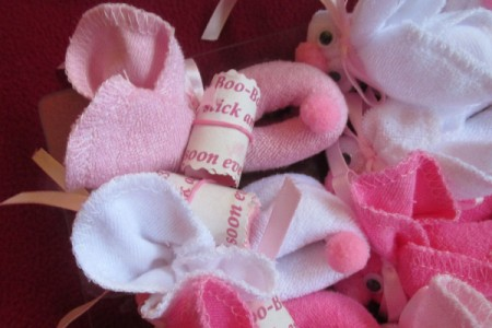 Make Boo-Boo Bunnies For a Baby Shower - tags attached to bunnies with elastic