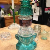 A glass tower made from thriftstore glass pieces.