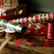 A pile of Christmas wrapping paper and ribbons.