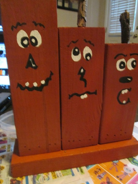 Scrap Wood Halloween Decorations - boards pained brown with goofy faces