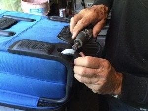 Repairing a Lopsided Luggage Wheel - sand to shape